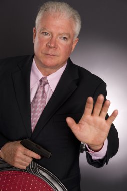 Business Man Defends Himself Holding Small Semi Sutomatic Handgun Weapon