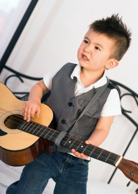 Young Boy Jamming Full Size Guitar Gritting Teeth Playing Musician