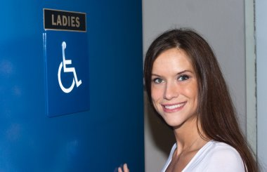Attractive Woman Enters Ladies Bathroom Women's Handicapped Lavatory
