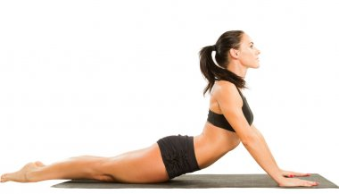 Fitness woman make stretch on yoga and pilates pose on isolated