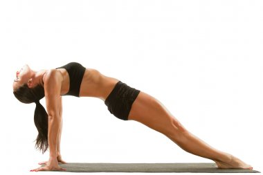 Young woman in sports bra on yoga pose