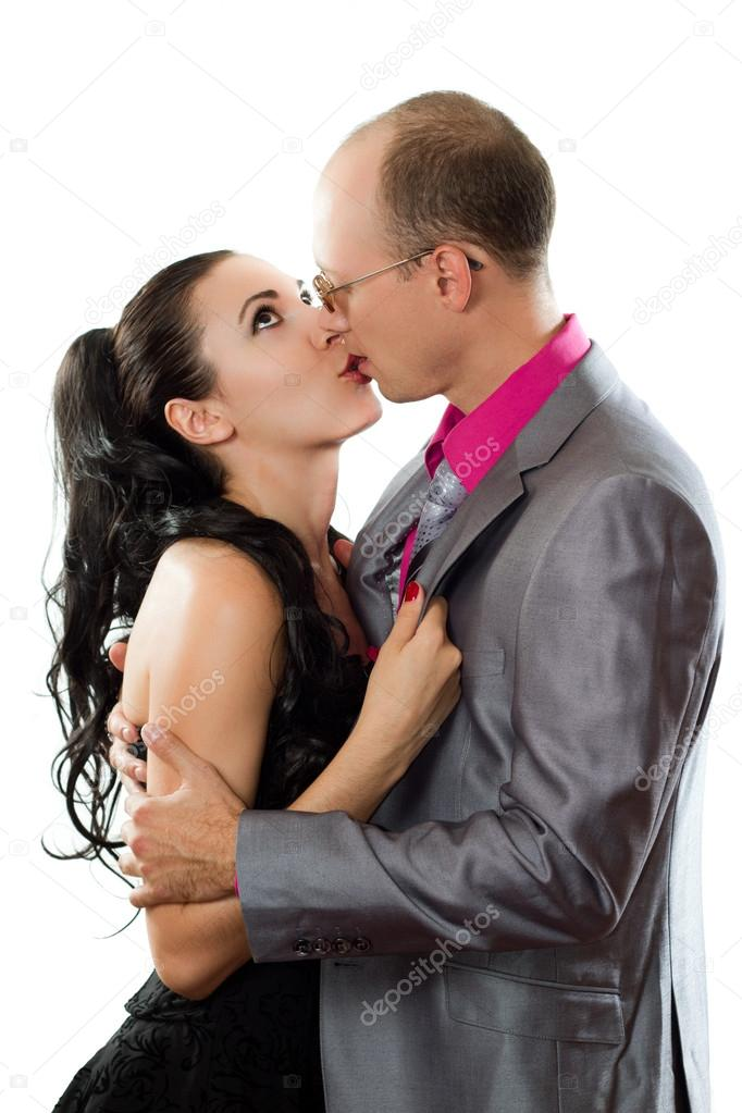 Loving Husband And Wife Kissing On A White Background Stock Photo