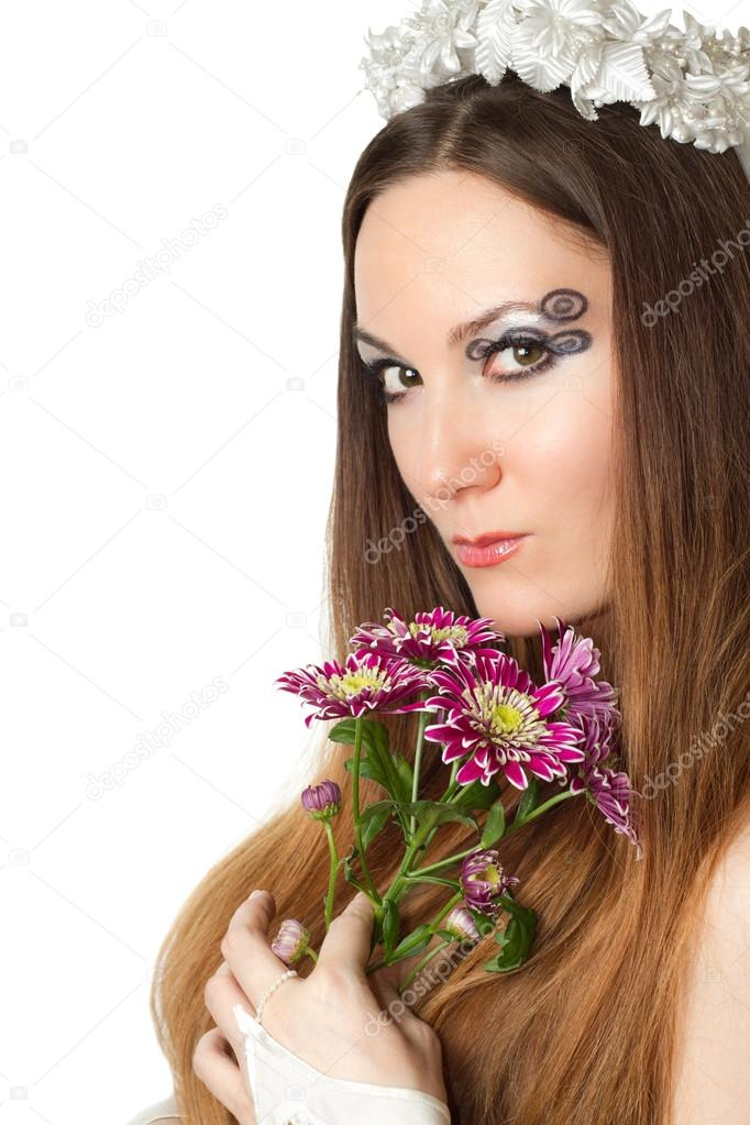 Wedding concept. Beautiful woman bride with creative make-up, body art and long hair on white background