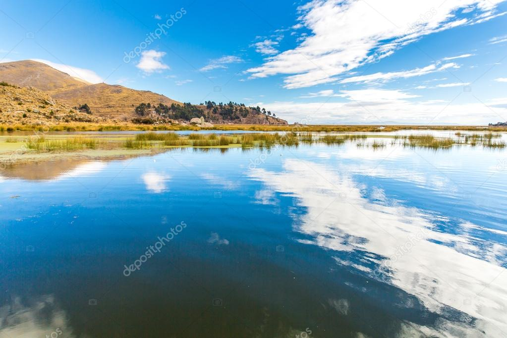 Lake Titicaca,South America, located on border of Peru and Bolivia. It sits 3,812 m above sea level, making it one of the highest commercially navigable lakes in the world.