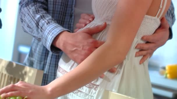 The man embraces the pregnant wife. Slow motion.
