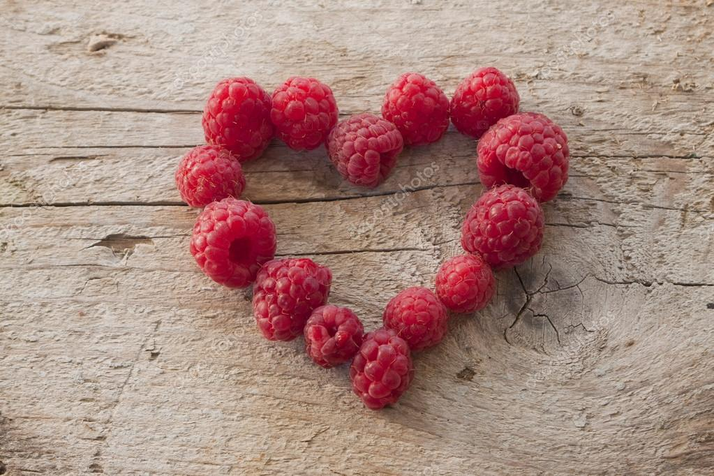 Some raspberries in a heart shape