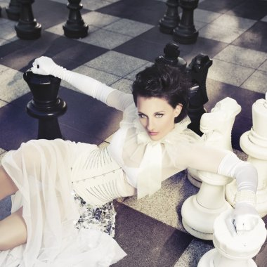 Beautiful woman in a giant chess game