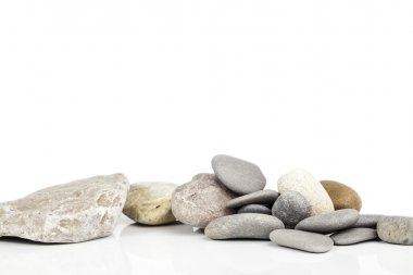 river stones on white background