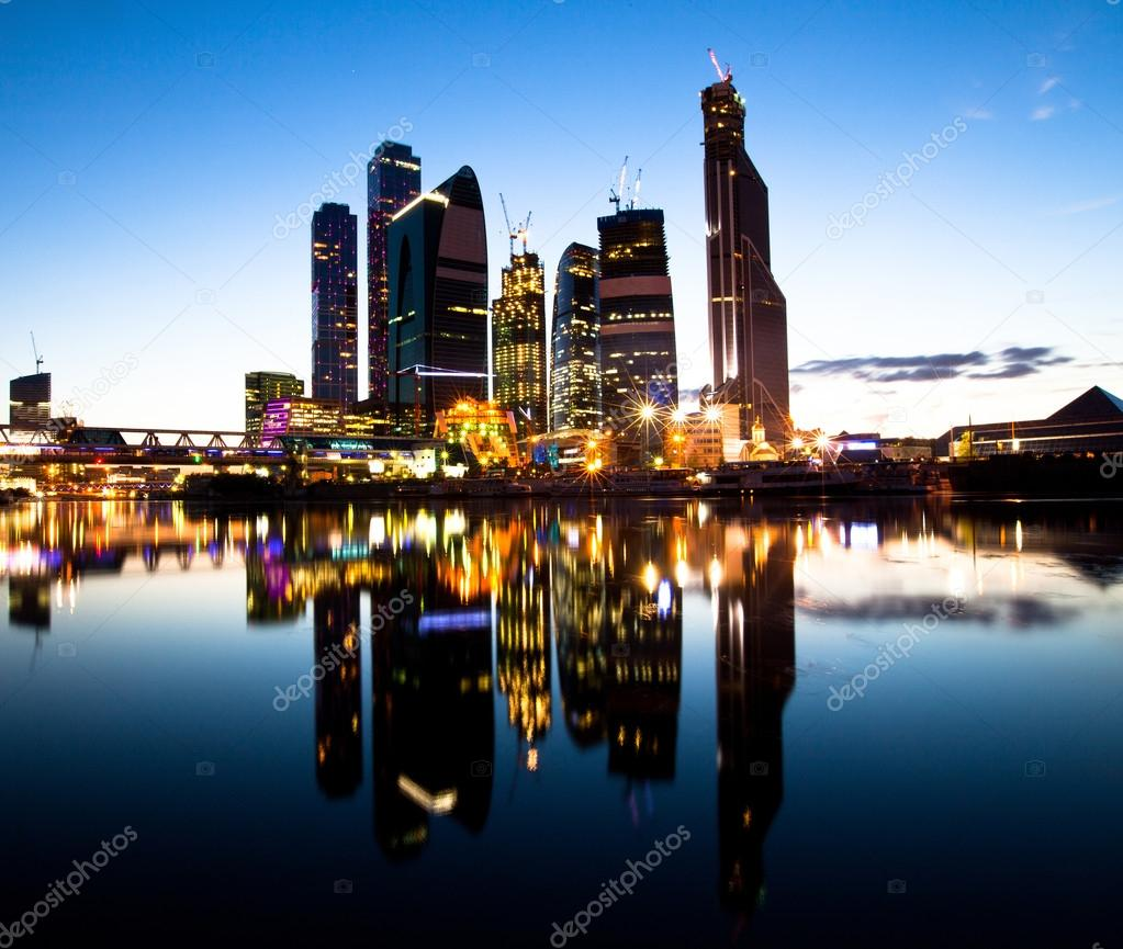 New skyscrapers Moscow business centre (Moscow City) at evening with water reflections.