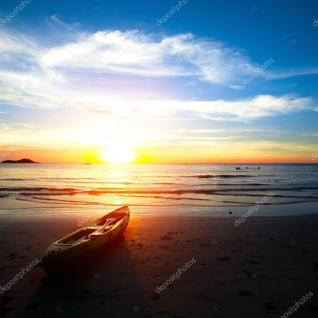 Kayak on the beach at sunset.