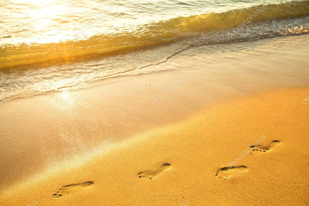 Footprint on sand with foam.