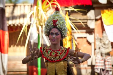 BALI, INDONESIA - APRIL 9: Balinese girl posing for turists before a classic national Balinese dance