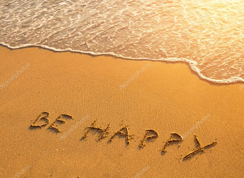 The inscription on the beach sand: Be Happy