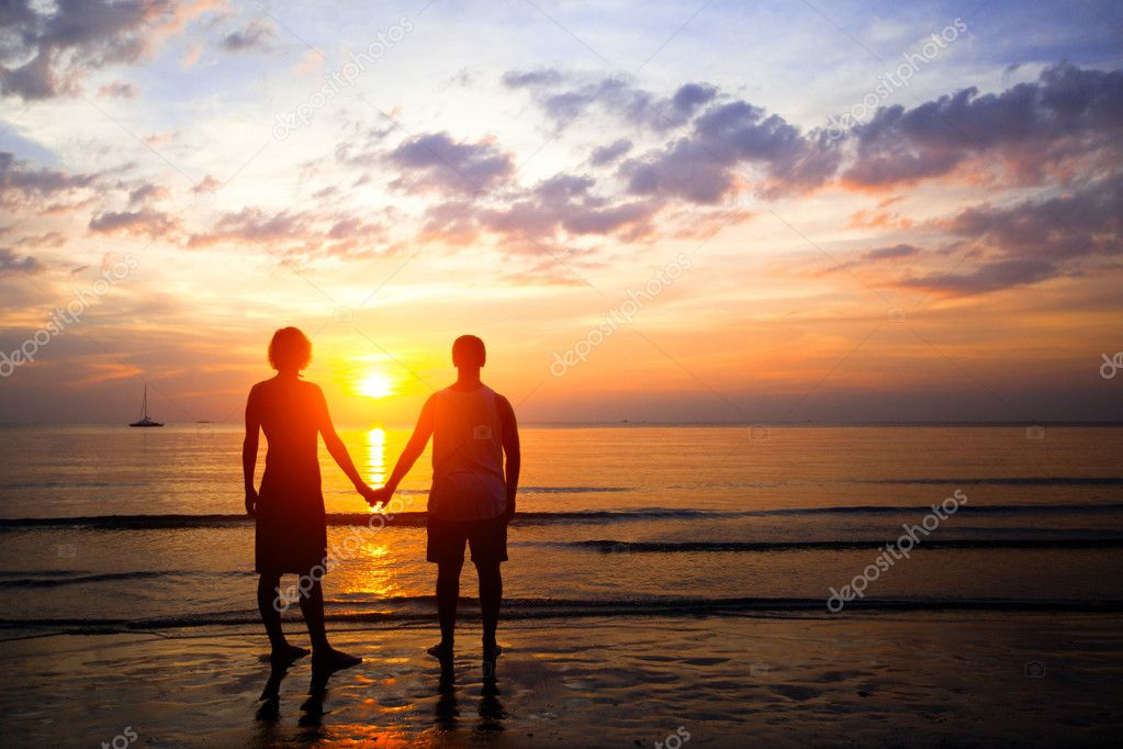 Young couple in love at sunset on the seashore