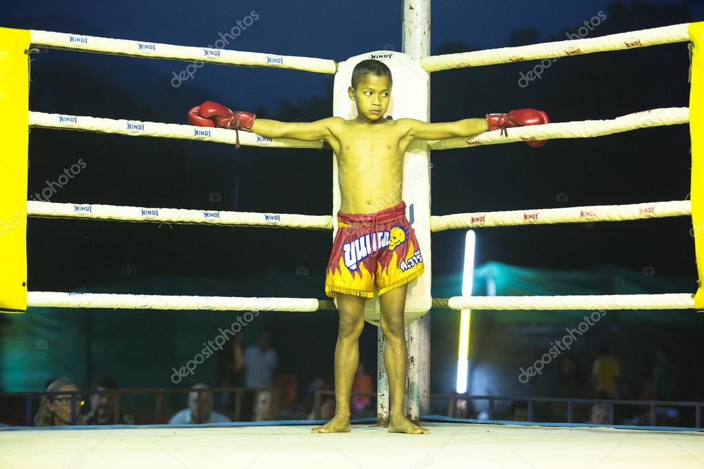 CHANG, THAILAND - FEB 22: Unidentified young Muaythai fighter in ring during match, Feb 22, 2013 on Chang, Thailand