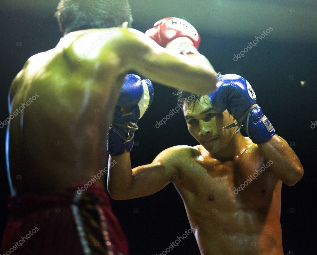 CHANG, THAILAND - FEB 22: Unidentified Muay Thai fighters compete in an amateur kickboxing match, Feb 22, 2013 on Chang, Thailand