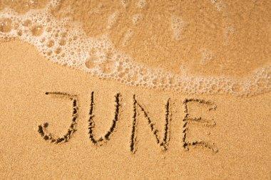 June - written in sand