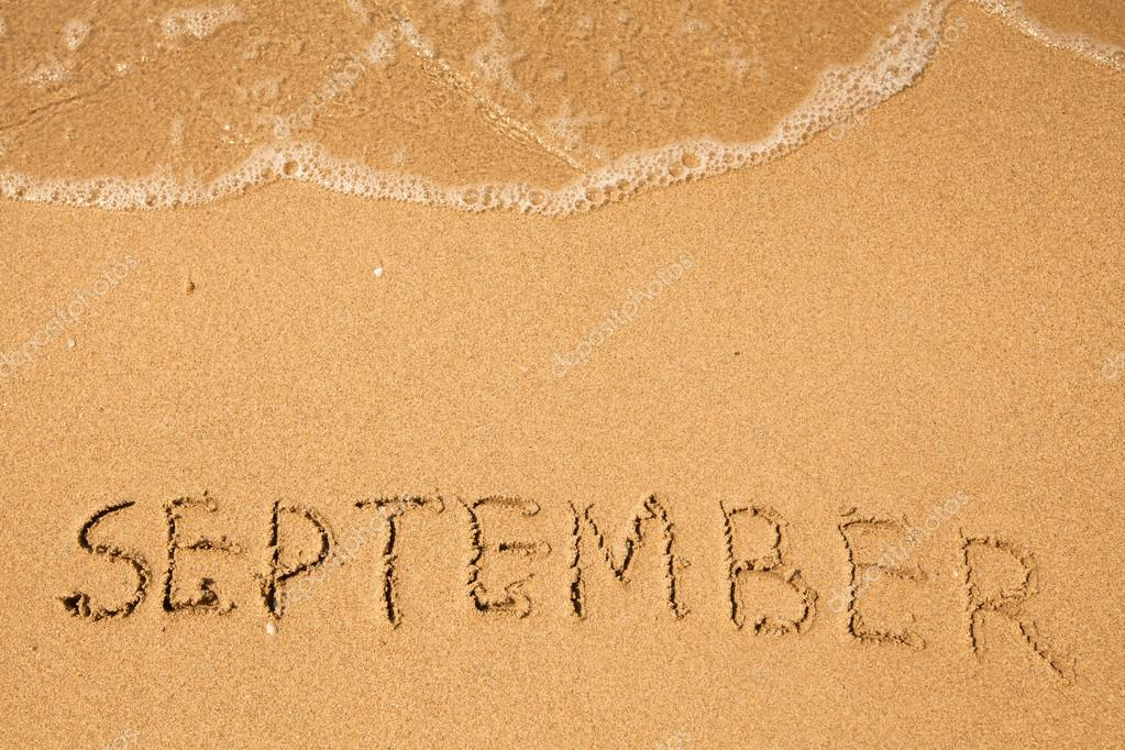 September - written in sand