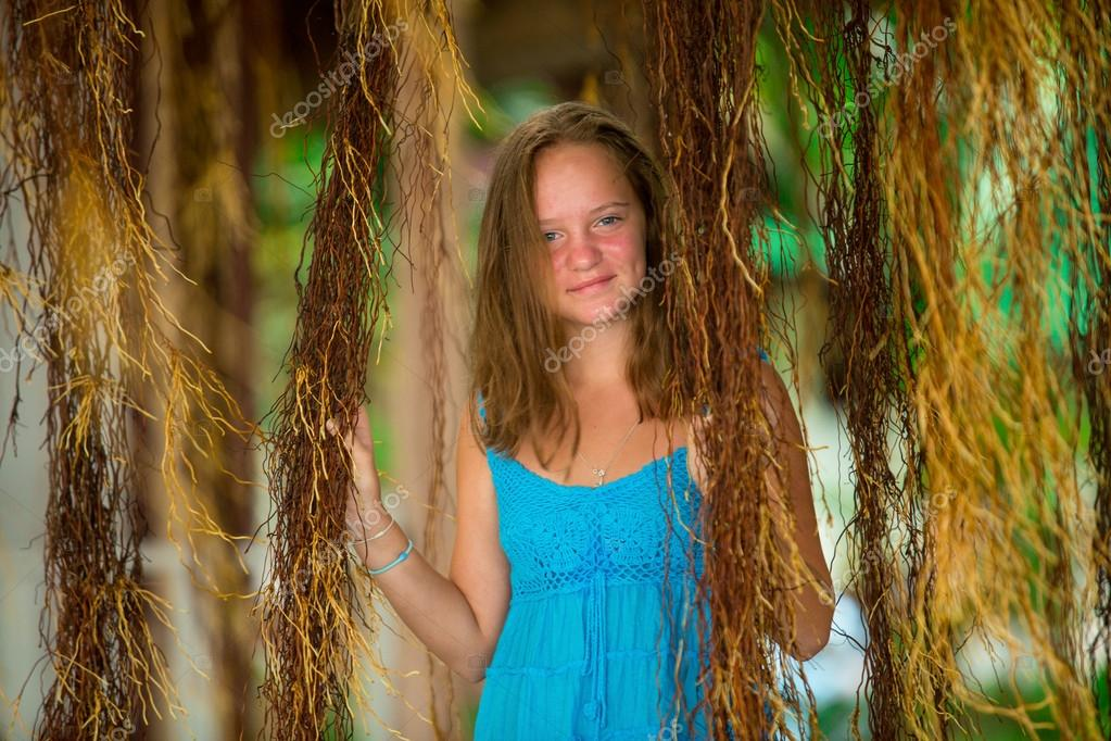 Teengirl in a blue dress in mangrove forest.
