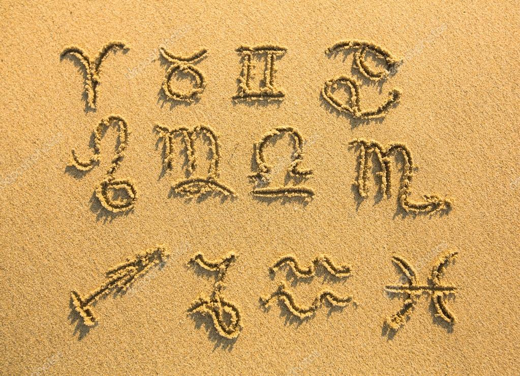 Set of zodiac signs (drawn on the facture beach sand)
