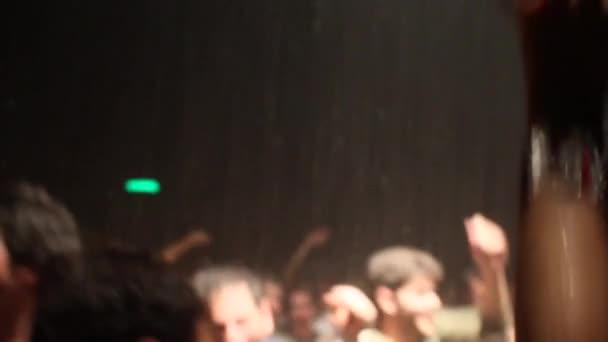 Blurring abstract people dancing in night club (HD)