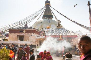 Unidentified tibetan Buddhist monks near stupa Boudhanath