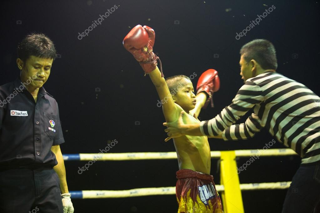 Unidentified young Muaythai fighter in ring during match