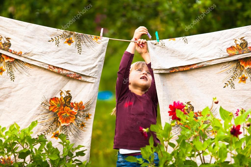 Little girl with  clothes line