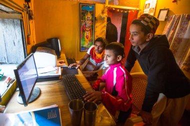 Children in lesson on the computer at Jagadguru School
