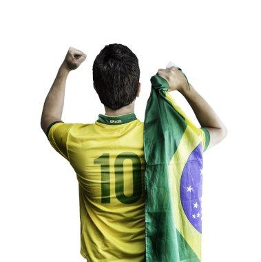 Brazilian soccer player holding the flag of Brazil celebrates