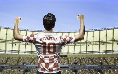 Croatian soccer player celebrates with the fans on the stadium