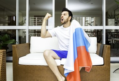 Russian fan celebrates at home