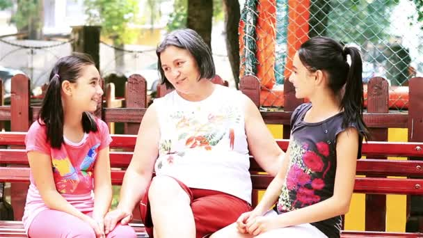 Grandmother with granddaughters talking