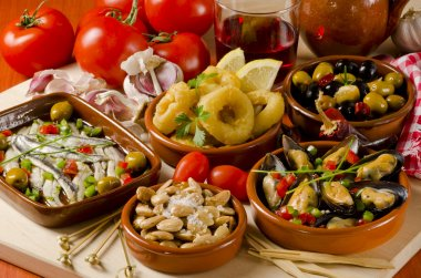 Spanish Cuisine. Assorted tapas on ceramic plates.