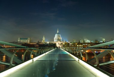 Night shot of the millennium bridge over the river Thames in Lon