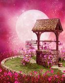 Fotografia vecchio pozzo in uno scenario di rosa