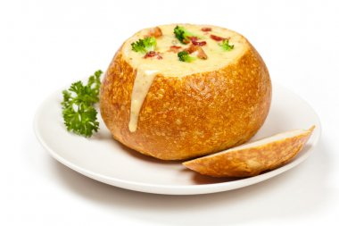 Sourdough bread bowl filled with broccoli cheese soup