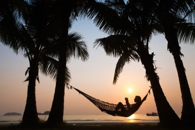 sunset in hammock on the beach