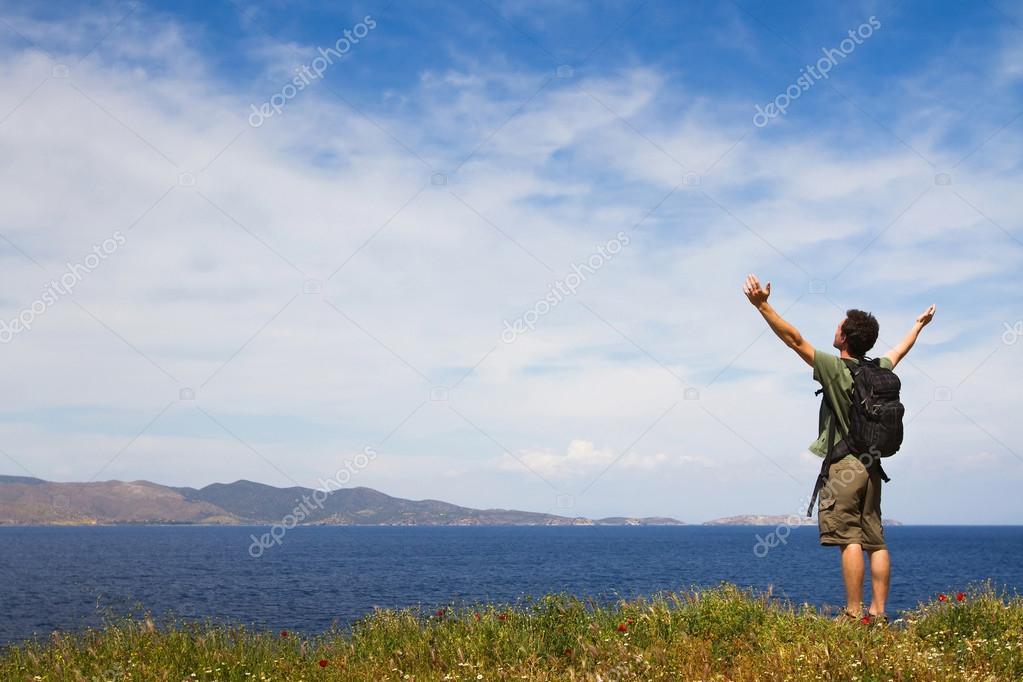 Young tourist enjoying sea view