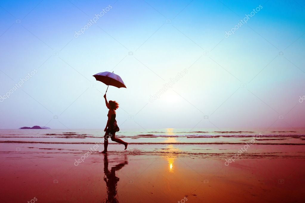Running woman with umbrella