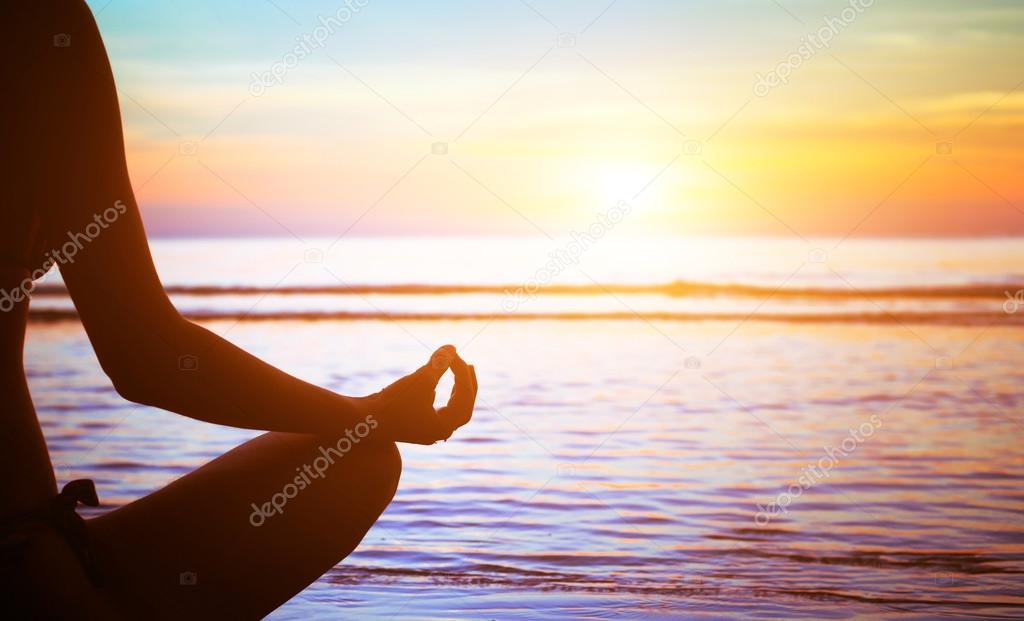 Yoga practicing at sunset