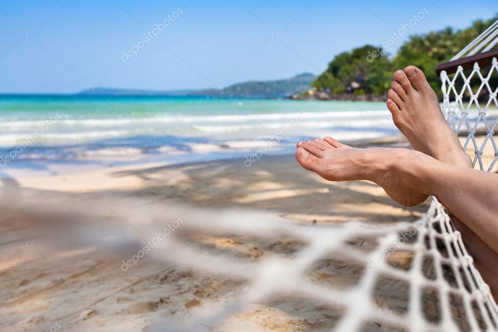 Woman feet in hammock