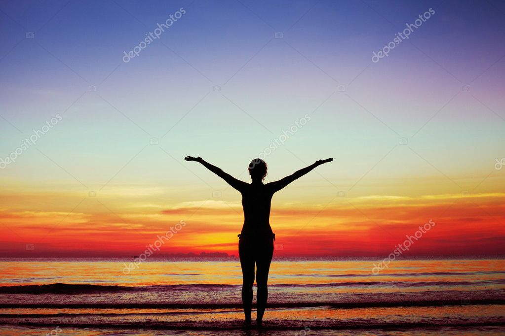 Woman on the beach on sunset