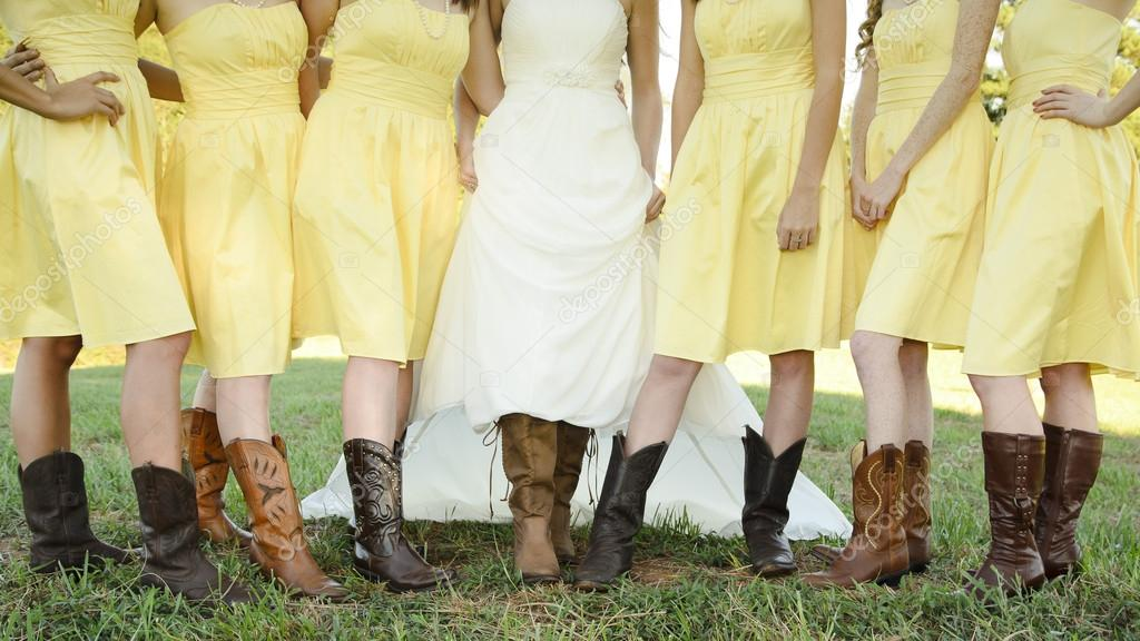 497a95fecf89 Bride and Bridesmaids show off their boots at a country wedding.