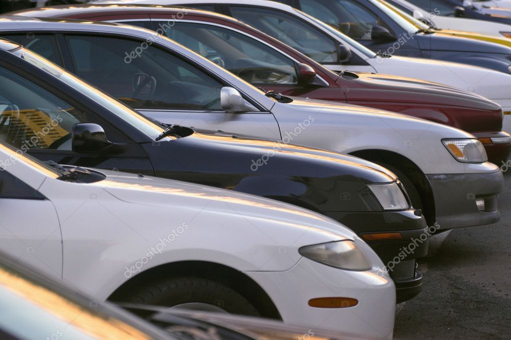 A line of used cars in a car lot. stock vector