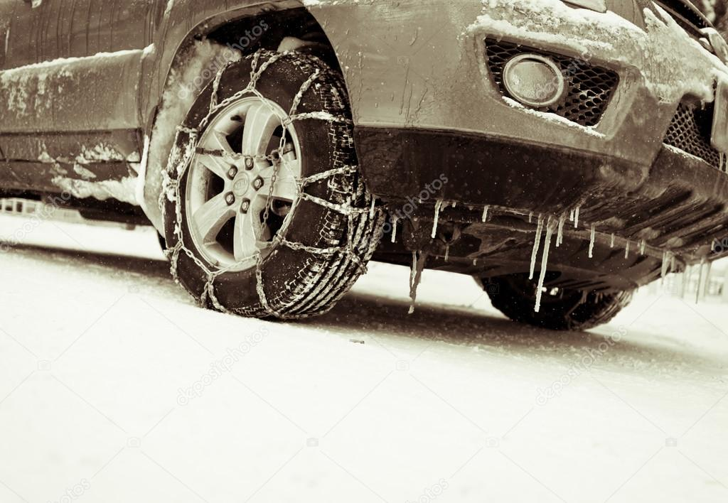 The car in the snow, tire mounted snow chains