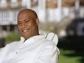 Fotografie Američan Afričana muž venku usmívá