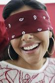 Fotografie Hispanic woman wearing blindfold