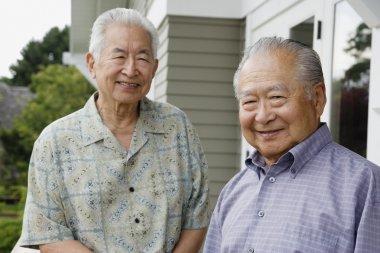 Portrait of two elderly men smiling