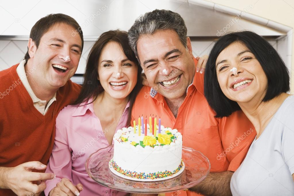 Middle-aged man celebrating birthday with friends